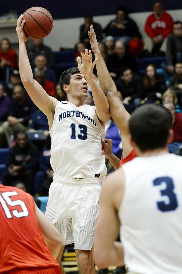 Northwood's David Jelinek shoots during the first half on Saturday at Riepma Arena on the NU campus. Northwood won 64-63. Photo: NICK KING | Nking@mdn.net