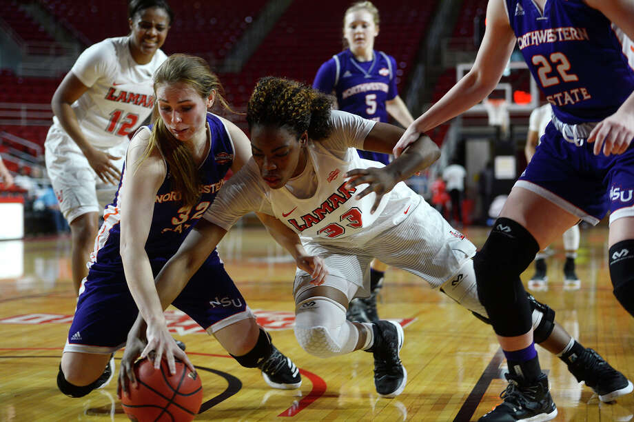 Northwestern State's Cheyenne Brown and Lamar forward Kiandra Bowers fight for a loose ball during the second quarter of a women's basketball game at the Montagne Center on Saturday.  Photo taken Saturday 1/28/17 Ryan Pelham/The Enterprise Photo: Ryan Pelham / ©2017 The Beaumont Enterprise/Ryan Pelham