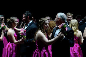 Symphony belles dance with their fathers and other family members during father-daughter dance at the Symphony League of Beaumont's Symphony Ball on Saturday. Photo taken Saturday 1/28/17 Ryan Pelham/The Enterprise