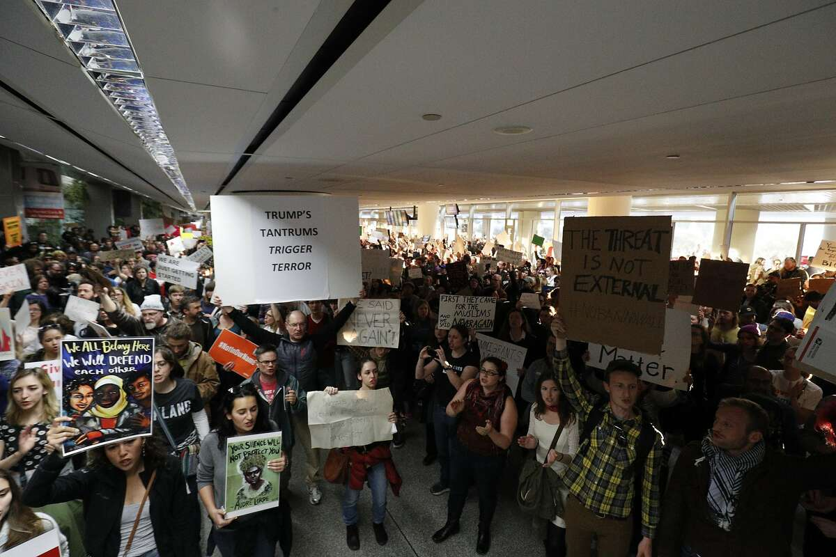 An immigration ban protest took place at San Francisco International Airport and several other airports nationwide in response to President Donald Trump's new immigration policies. Here are some of the signs from the protest.