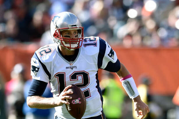 FILE - In this Oct. 9, 2016, file photo, New England Patriots quarterback Tom Brady (12) runs with the ball during an NFL football game against the Cleveland Browns, in Cleveland. The Falcons (13-5) take on the New England Patriots (16-2) in Super Bowl LI in Houston on Feb. 5, 2017. (AP Photo/David Richard)
