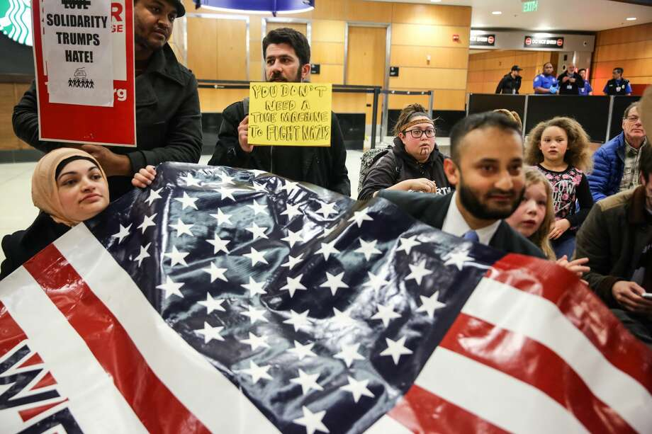 Protesters flood the baggage claim area at Seattle-Tacoma International Airport on Saturday, Jan. 28, 2017, objecting to President Trump's executive order restricting immigration from certain countries. Photo: GENNA MARTIN, SEATTLEPI.COM