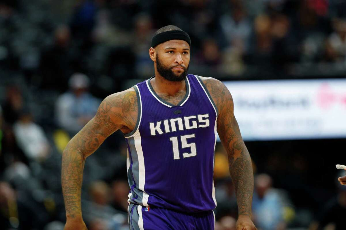 Sacramento Kings forward DeMarcus Cousins (15) in the second half of an NBA basketball game Tuesday, Jan. 3, in Denver. Longtime Sacramento Kings broadcaster Grant Napear has resigned after he tweeted