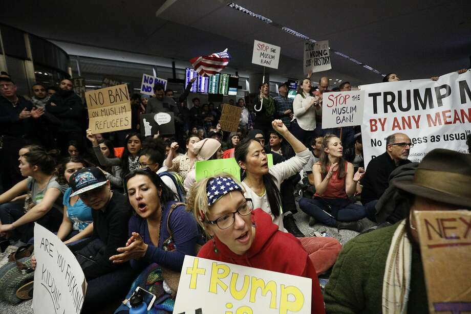 Protesters of President Trump's travel ban on refugees and immigrants from seven Muslim countries block traffic for arrivals to San Francisco International Airport on Saturday. Photo: Paul Kuroda, Special To The Chronicle