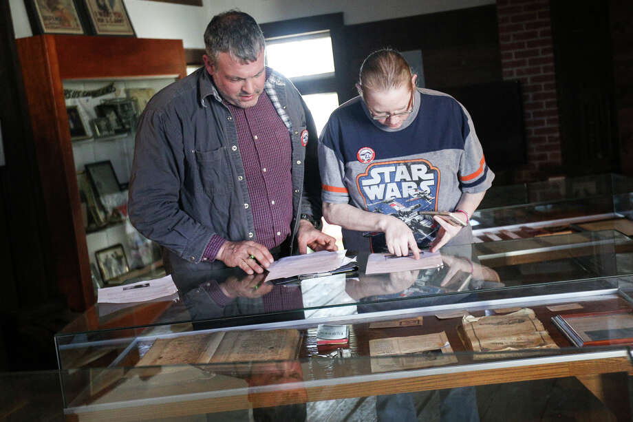 Conroe residents John and Jessica Courtney search for scavenger hunt items in the 4th annual Montgomery County Historical Commission's History Road Rally on Saturday at the Historic Magnolia Depot, a train depot turned museum. Photo: Michael Minasi, Staff Photographer / © 2017 Houston Chronicle