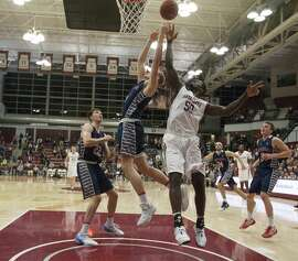 Saint Mary's Jock Landale (34) and Santa Clara's Emmanuel Ndumanya (50) vie for a rebound during the first half of an NCAA college basketball game Saturday, Jan. 28, 2017, in Santa Clara, Calif. (AP Photo/D. Ross Cameron)