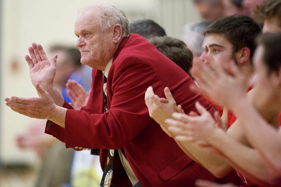 FILE — Beaverton boys' basketball coach Roy Johnston applauds his team from the bench in a game.