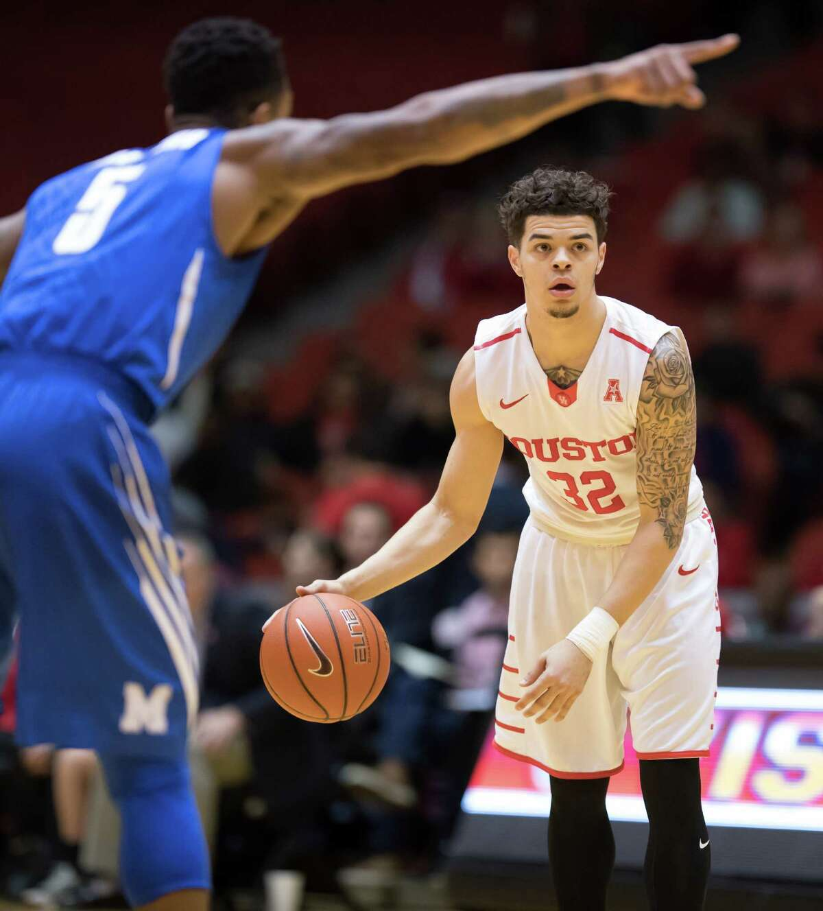Rob Gray (32) of the Houston Cougars looks to pass the ball in the first half against the Memphis Tigers in a college basketball game on Thursday, January 19, 2017 at Hofheinz Pavilion.