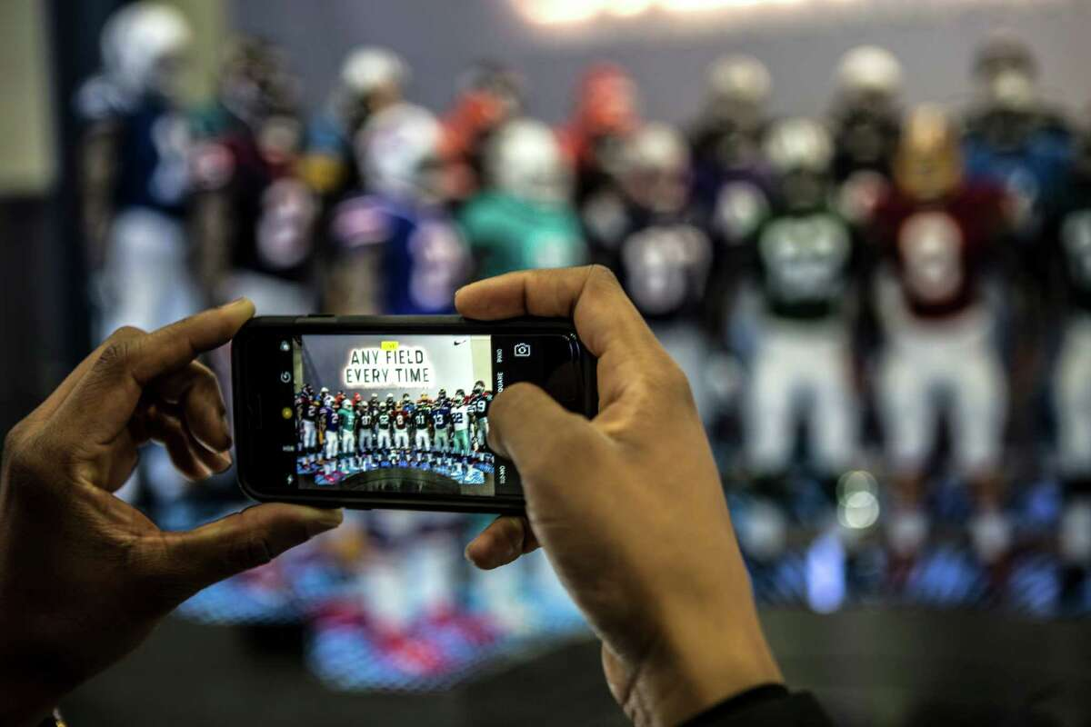 Various NFL uniforms are photographed during a preview of NFL Experience driven by Genesis at the George R. Brown Convention Center on Friday, Jan. 27, 2017, in Houston. The interactive attraction opens to the public on Saturday.