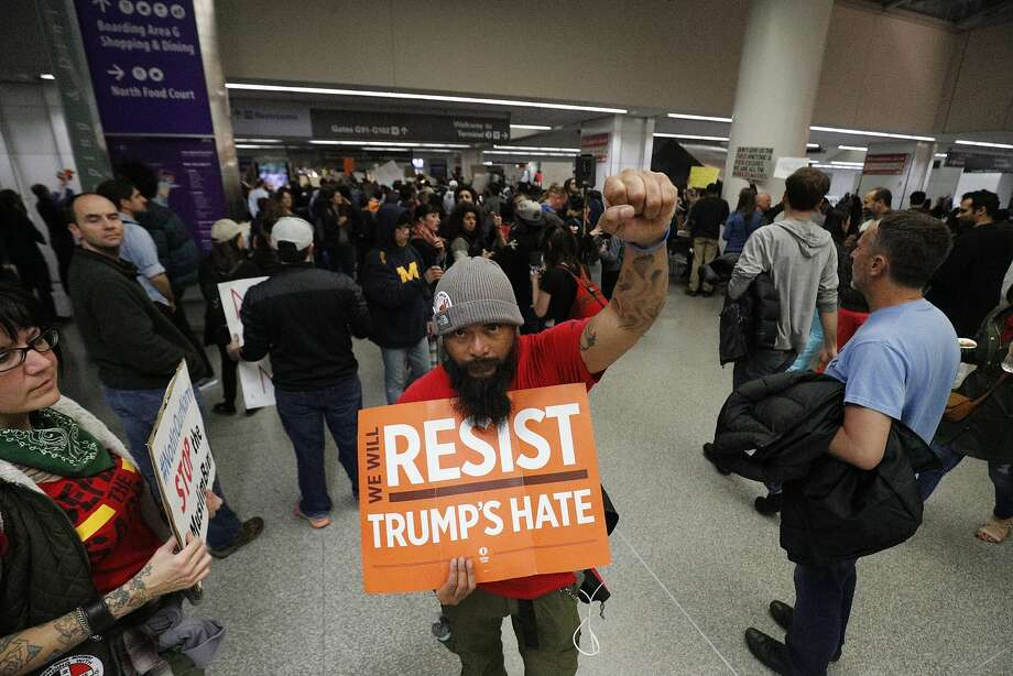 Ron Valenzuela protests at SFO on Saturday, Jan. 28, 2017 in San Francisco, Calif. Photo: Paul Kuroda, Special To The Chronicle