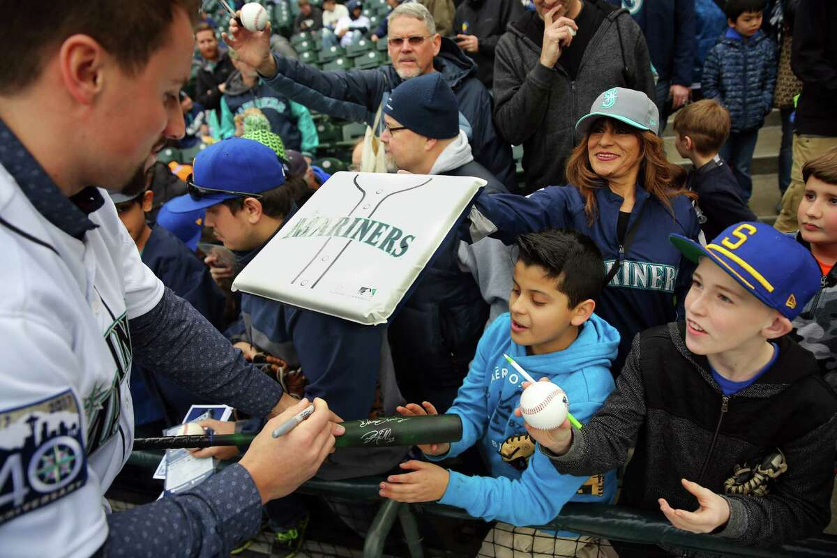 Newly acquired Mariners pitcher Dan Altavilla signs autographs during Mariners FanFest at Safeco Field, Saturday, Jan. 28, 2017.