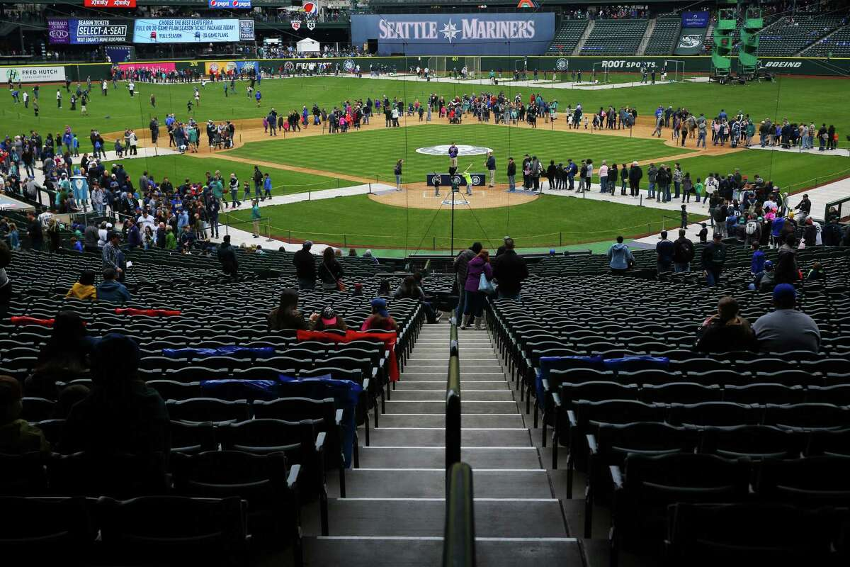 People explore the field during Mariners FanFest at Safeco Field, Saturday, Jan. 28, 2017.