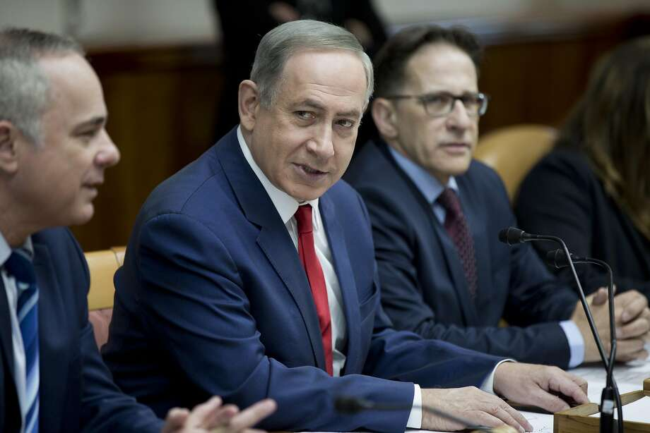 Israeli Prime Minister Benjamin Netanyahu (center) meets with his Cabinet. He says the U.S. Embassy should be in Israel's capital of Jerusalem rather than the current Tel Aviv location. Photo: ABIR SULTAN, AFP/Getty Images