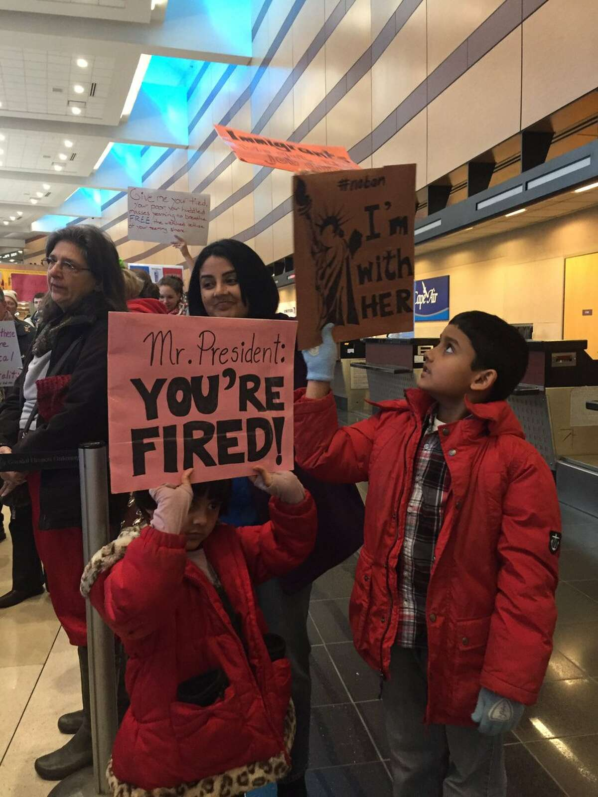 Children were among the protestors who filled the first floor of Albany International Airport Sunday, Jan. 29, 2017, who were speaking out against President Donald Trump's immigration order that stopped refugees from seven Muslim-majority nations from entering the U.S. (Amanda Fries/Times Union)