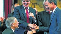 Joe Straus, right, accepts congratulations from Gov. Greg Abbott and Lt. Gov. Dan Patrick, center, after being sworn in as speaker of the House during the opening of the 2015 Legislature.