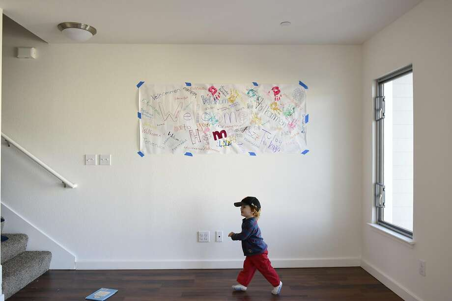 Keegan Longaway, 2, runs past a welcome banner, in his family's new condo, following a Habitat Terrace Home Dedication ceremony held by Habitat for Humanity of Greater San Francisco where they and 10 other families receive the keys to their new homes, in San Francisco, CA on Saturday, January 28, 2017. Photo: Michael Short, Special To The Chronicle