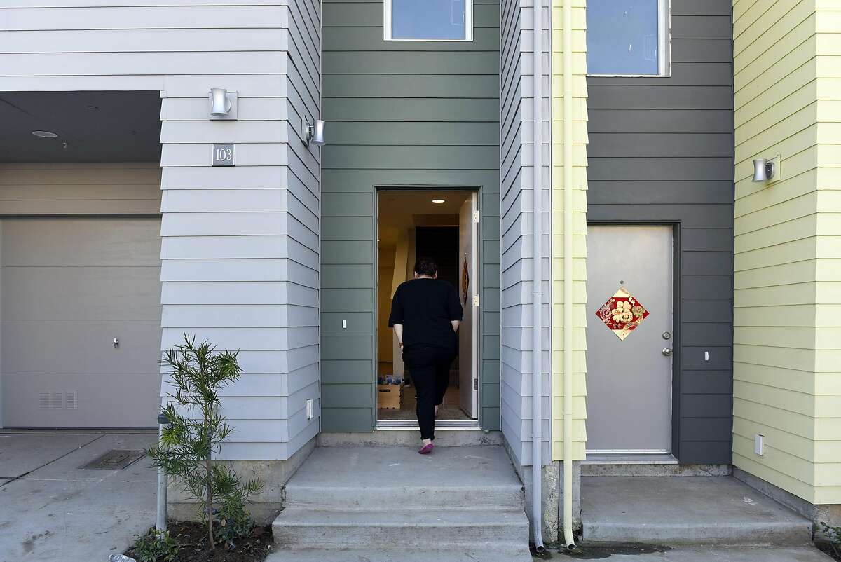 Jennifer Longaway, walks in the front door of her family's new condo, following a Habitat Terrace Home Dedication ceremony held by Habitat for Humanity of Greater San Francisco where they and 10 other families receive the keys to their new homes, in San Francisco, CA on Saturday, January 28, 2017.