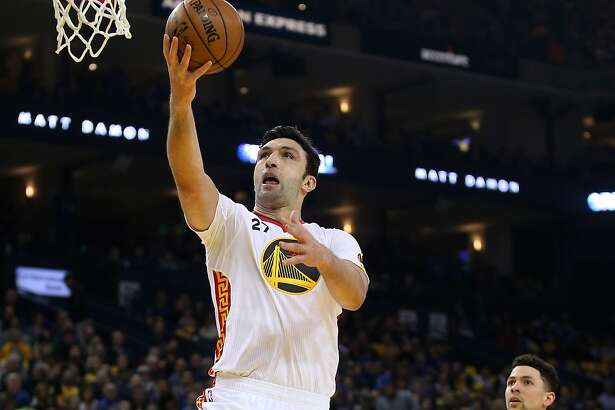 Golden State Warriors center Zaza Pachulia (27) shoots during the first half of an NBA basketball game between the Golden State Warriors and the Los Angeles Clippers at Oracle Arena on Saturday, Jan. 28, 2017 in Oakland, Calif. Warriors lead 72-51 at half time.