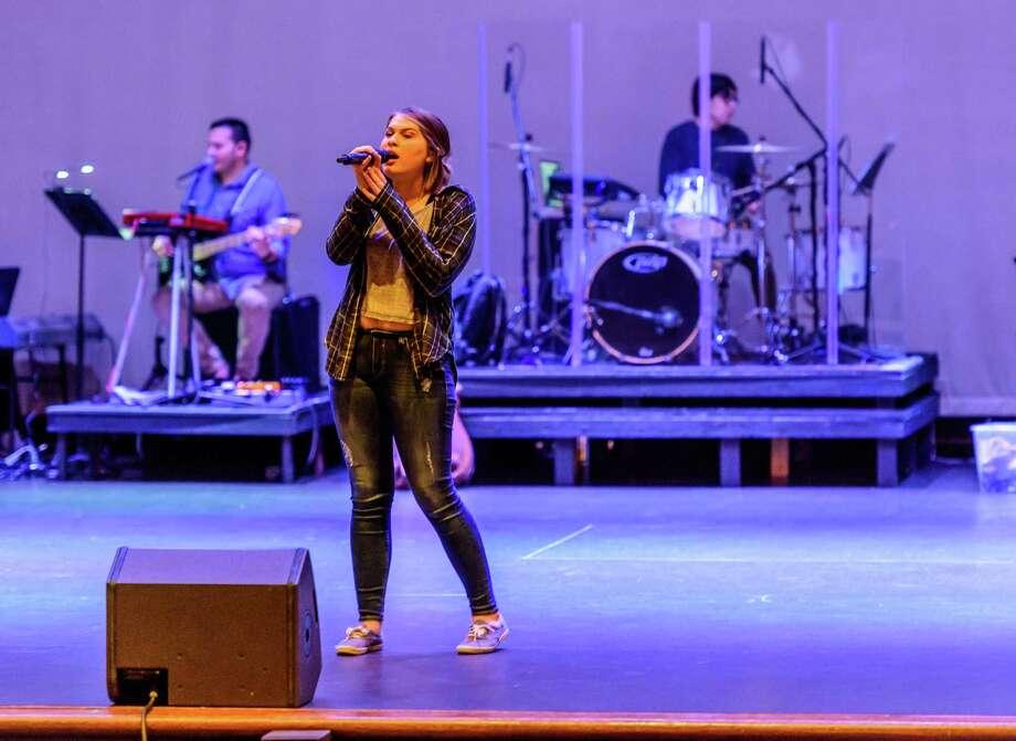 "Jenna Pierce, a junior at Deer Park High School, sings with the s band during the rehearsal of the ""Hello Texas"" show at Deer Park High School. Photo: ÂKim Christensen, Photographer / ©Kim Christensen"