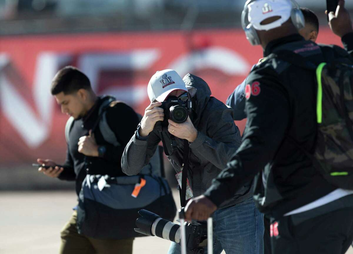 An NFL photographers takes photos as the Atlanta Falcons arrive at George Bush Intercontinental Airport on Sunday, Jan. 29, 2017, in Houston. The Falcons play the New England Patriots in Super Bowl LI at NRG Stadium on February 5.
