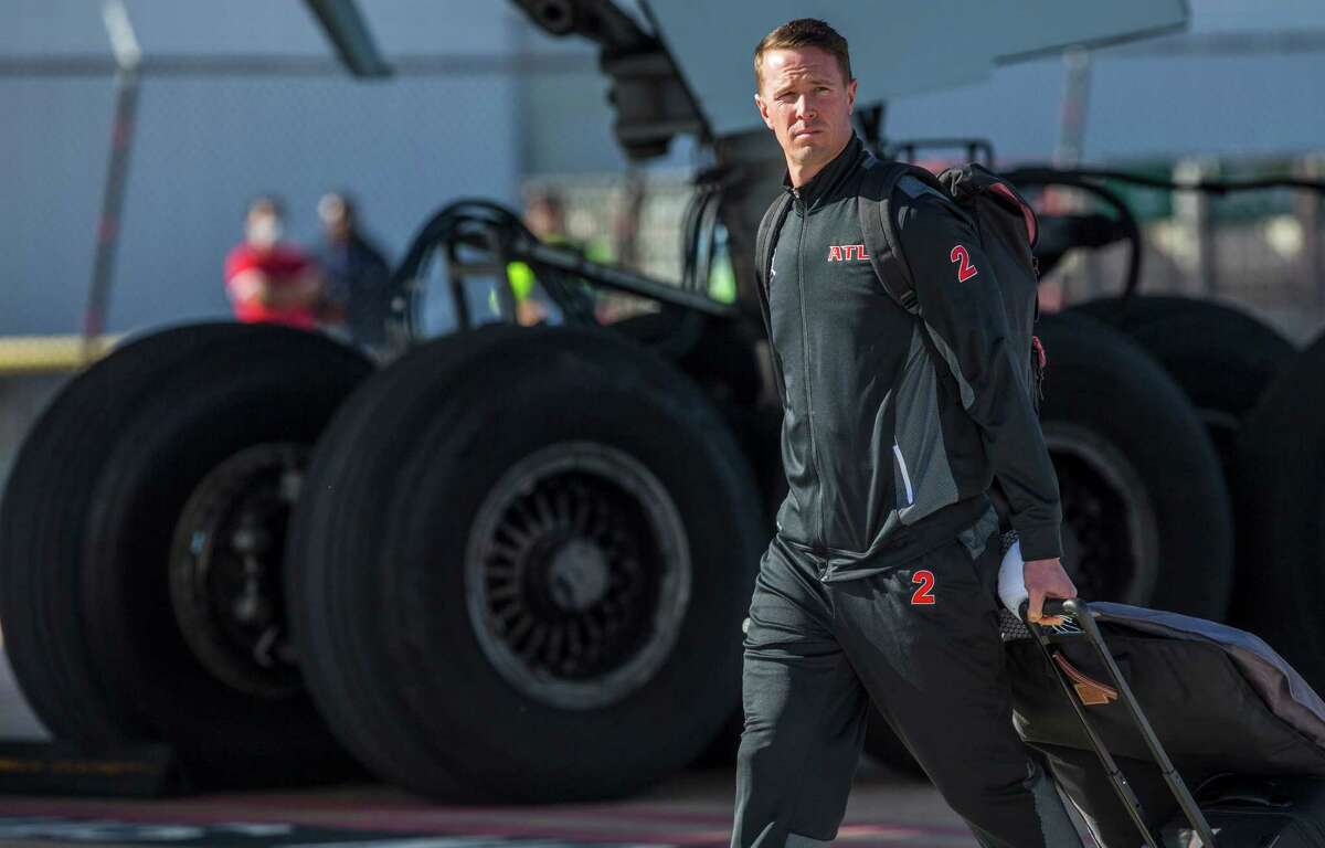 Atlanta Falcons quarterback Matt Ryan walks off the team charter as the Falcons arrive for Super Bowl LI at George Bush Intercontinental Airport on Sunday, Jan. 29, 2017, in Houston. The Falcons play the New England Patriots in Super Bowl LI at NRG Stadium on February 5.