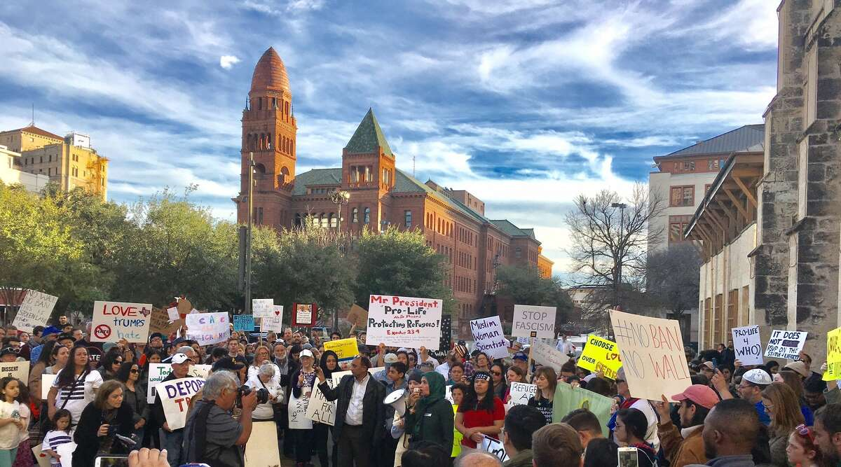 Locals hit Main Plaza downtown Sunday, Jan. 29, 2017, to protest President Donald Trump and Trump's latest executive order on immigration.