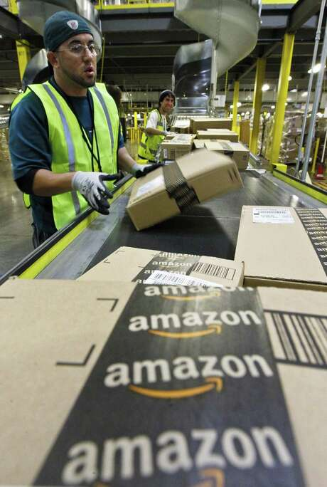 Amazon is the largest of seven retailers chosen for a two-year food-stamps program in which SNAP will accept online payment for groceries. The U.S. Department of Agriculture, which administers SNAP, sees access to online groceries as a benefit to urban and rural residents with limited shopping options. The pilot will let the agency work out any payment and security issues before allowing online food-stamp purchases nationally. Photo: Associated Press /File Photo / AP