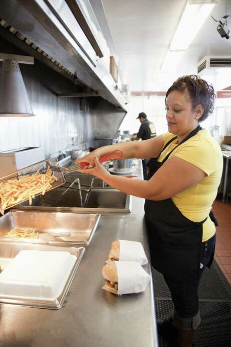 In today's tight labor market, restaurants are embroiled in a full-on food fight over workers. The scarcity of candidates may be raising the minimum wage without help from lawmakers. While good news for millions of lower-skilled workers who've felt left behind by the economic recovery, it may not be for companies and customers. Restaurants will either have to raise prices or accept falling margins. Some stores' service is suffering. Photo: Getty Images /File Photo / 2016 Getty Images