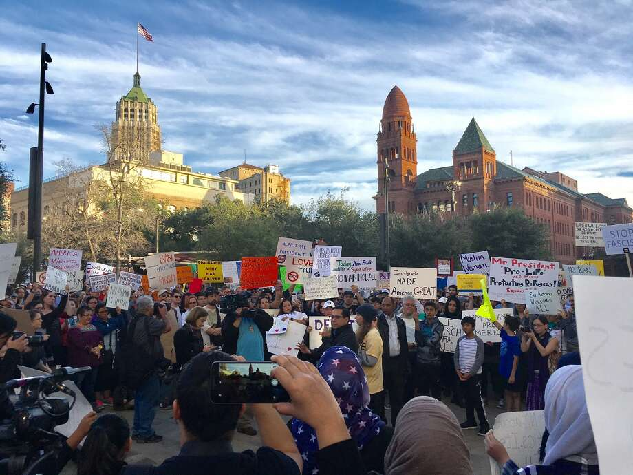 Locals hit Main Plaza downtown Sunday, Jan. 29, 2017, to protest President Donald Trump and Trump's latest executive order on immigration. Photo: By Vincent T. Davis