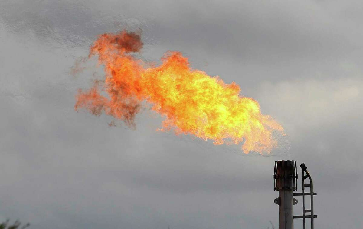 A gas flare burns at an oil lease in La Salle and Dimmit counties in this 2014 photo.