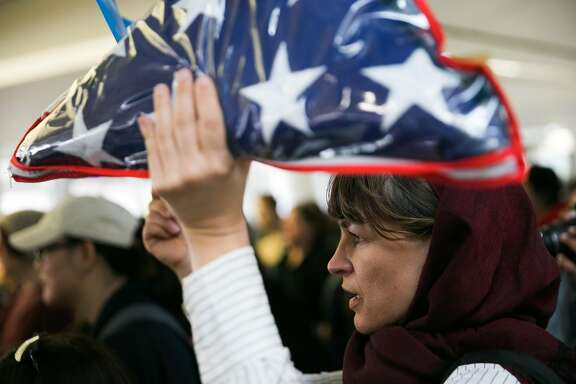 Cheri Renne demonstrates at the San Francisco Airport in San Francisco, Calif., for a demonstration against Donald Trump's executive order that bars citizen of seven from predominately Muslim countries from entering the U.S., Sunday, January 29, 2017.