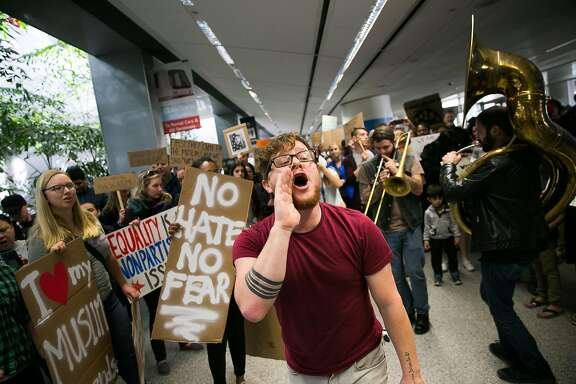 Demonstrators gather for a second day at the arrivals terminal at the San Francisco Airport in San Francisco, Calif., for a demonstration against Donald Trump's executive order that bars citizen of seven from predominately Muslim countries from entering the U.S., Sunday, January 29, 2017.