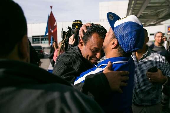 Ebraham Abuzaid kisses his brother, Mustafa Abuzaid,  after being released at the San Francisco Airport in San Francisco, Calif., Sunday, January 29, 2017.