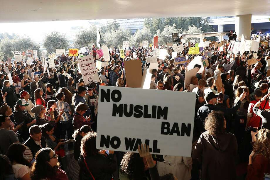 SAN FRANCISCO, CA - JANUARY 28: Demonstrators block traffic at the international arrival terminal as they protest against muslim immigration ban at San Francisco International Airport on January 28, 2017 in San Francisco, California. President Donald Trump signed an executive order Friday that suspends entry of all refugees for 120 days, indefinitely suspends the entries of all Syrian refugees, as well as barring entries from seven predominantly Muslim countries from entering for 90 days. (Photo by Stephen Lam/Getty Images) Photo: Stephen Lam, Getty Images
