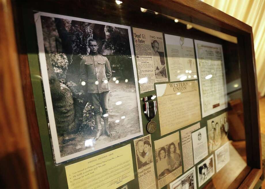 A collection of memorabilia that Ellis kept in footlockers inherited by his granddaughter is on display during the event. Photo: Kin Man Hui /San Antonio Express-News / ©2017 San Antonio Express-News