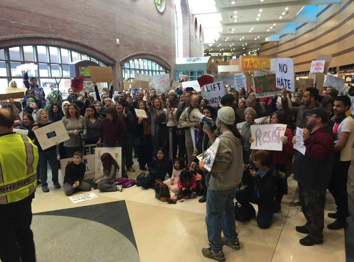Protestors fill the first floor of Albany International Airport Sunday, Jan. 29, 2017, in response to President Donald Trump's executive order to ban refugees and valid visa travelers from entering the U.S. from seven Muslim-majority nations. (Amanda Fries/Times Union)