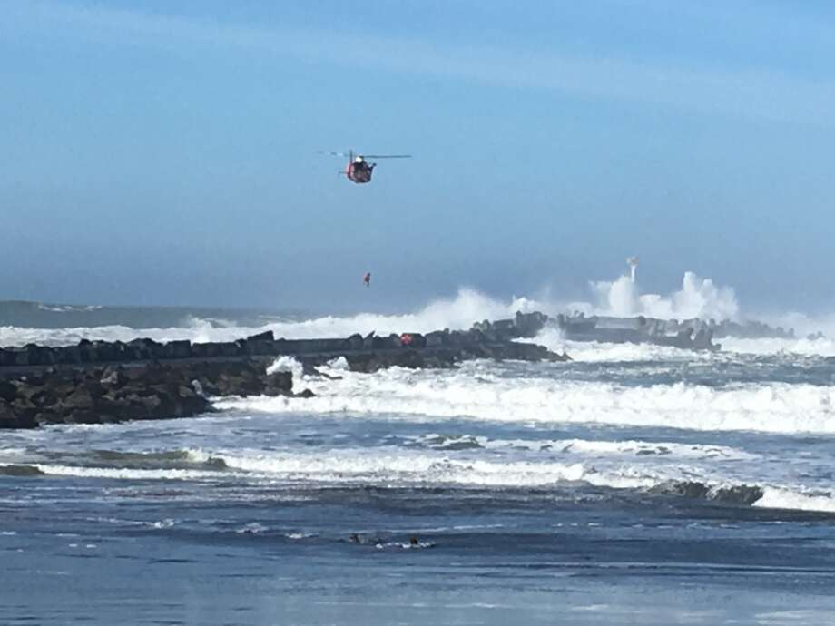 The Coast Guard rescued a driver trapped in high surf from Humboldt Bay's north jetty on Jan. 26, 2017. Photo: United States Coast Guard