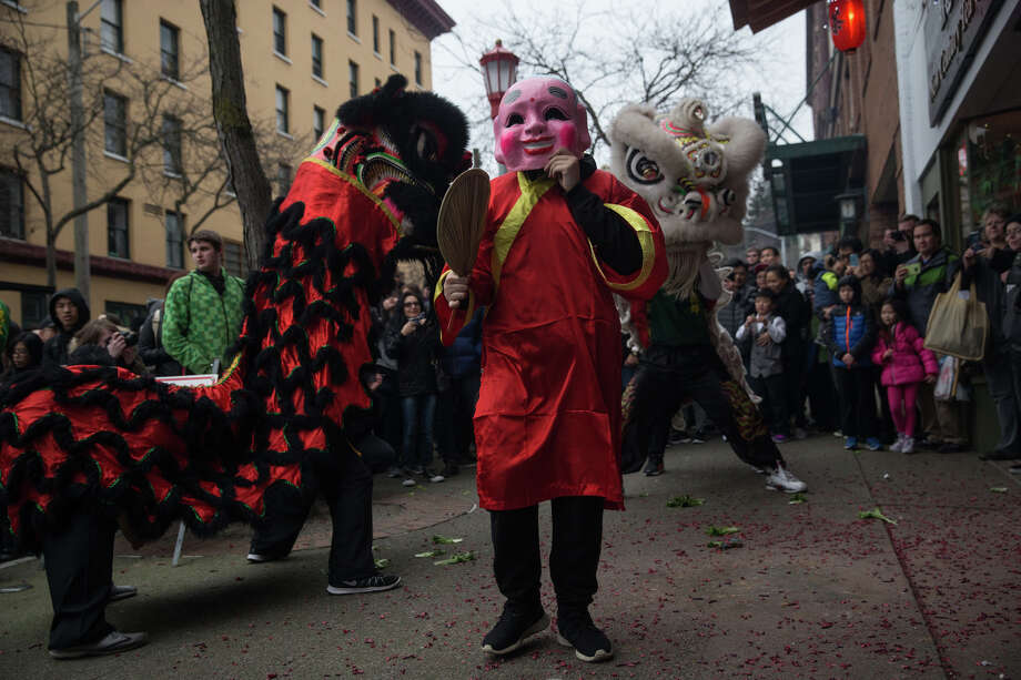 The Mak Fai Kun Fu Lion Dance Team blesses local businesses during the second day of the International District's Lunar New Year Celebration on Sunday, Jan. 29, 2017. Photo: GRANT HINDSLEY, SEATTLEPI.COM / SEATTLEPI.COM