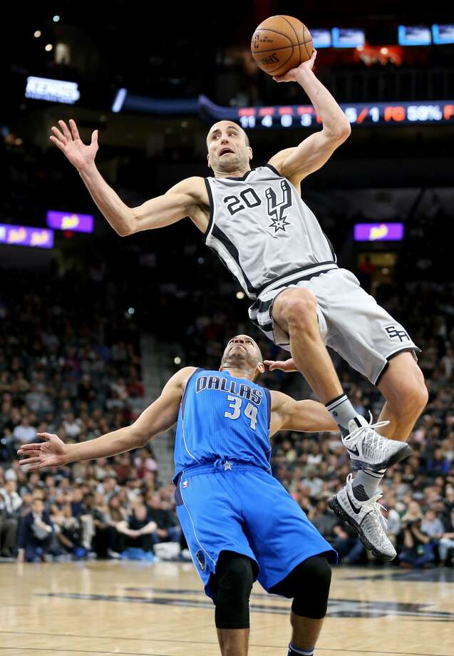 San Antonio Spurs' Manu Ginobili is fouled by Dallas Mavericks' Devin Harris during first half action Sunday Jan. 29, 2017 at the AT&T Center. Photo: Edward A. Ornelas/San Antonio Express-News