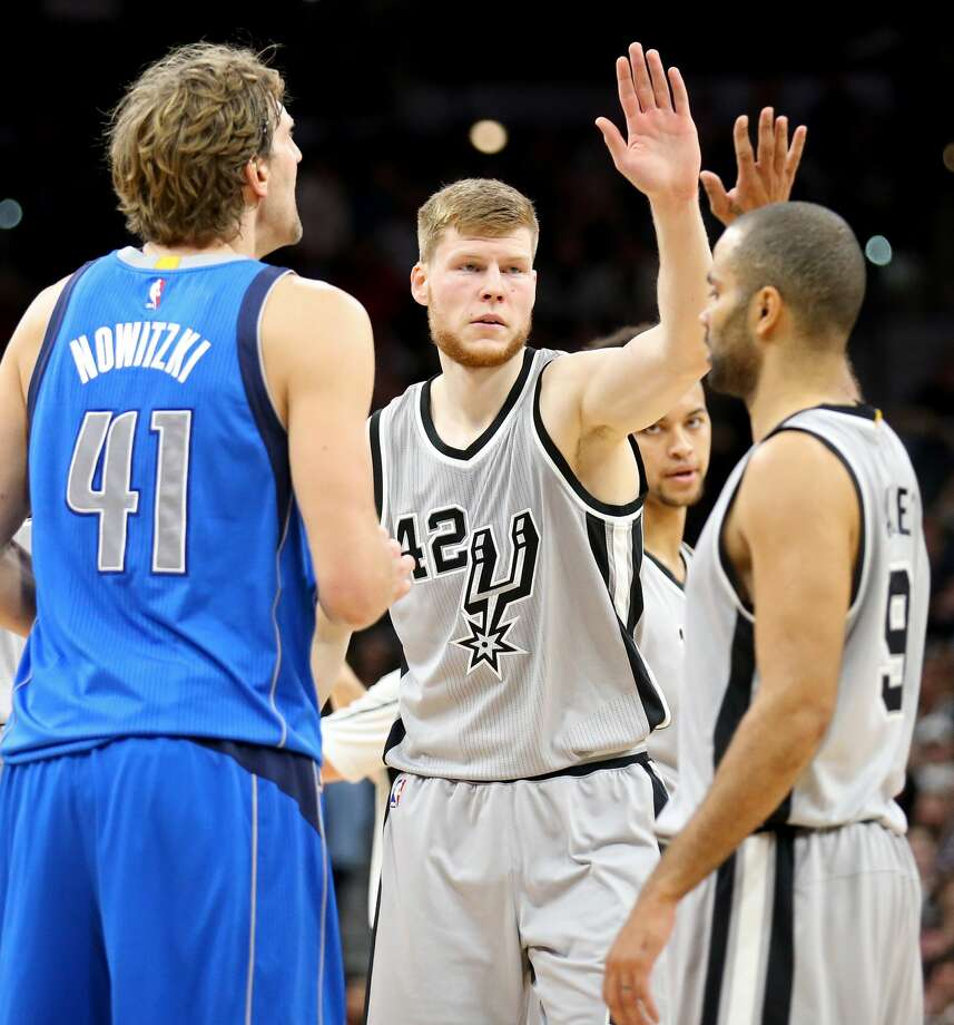 San Antonio Spurs' Davis Bertans celebrates with Tony Parker after making a 3-pointer as Dallas Mavericks' Dirk Nowitzki looks on during first half action Sunday Jan. 29, 2017 at the AT&T Center. Photo: Edward A. Ornelas/San Antonio Express-News