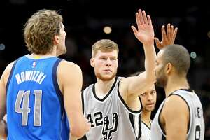 San Antonio Spurs' Davis Bertans celebrates with Tony Parker after making a 3-pointer as Dallas Mavericks' Dirk Nowitzki looks on during first half action Sunday Jan. 29, 2017 at the AT&T Center.