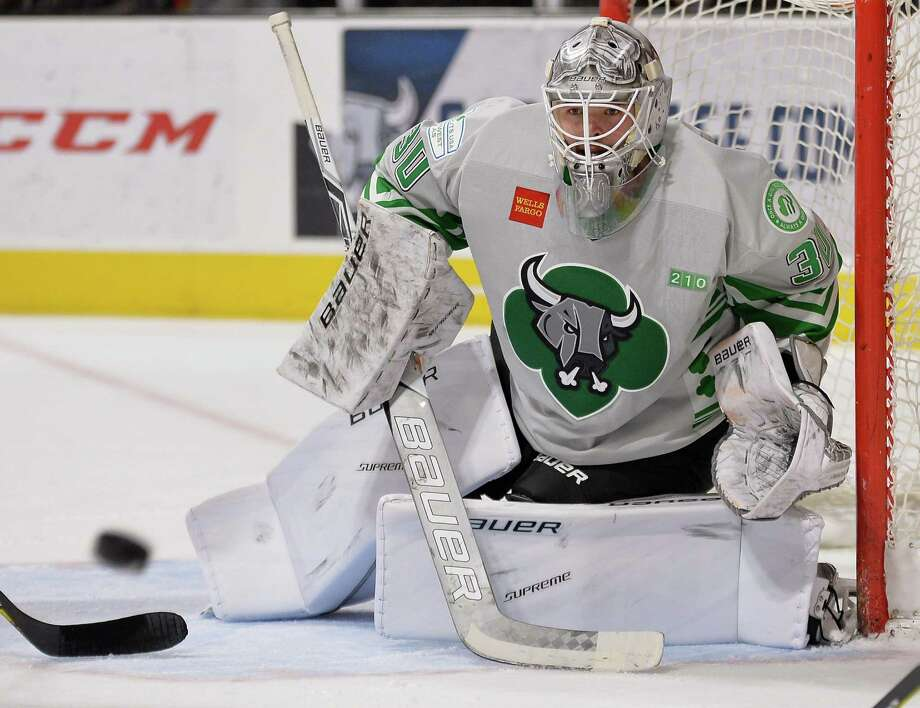 Rampage goaltender Spencer Martin watches the puck during the first period of an AHL game against the Iowa Wild, on Jan. 14, 2017, in San Antonio. Photo: Darren Abate /AHL / Darren Abate Media, LLC