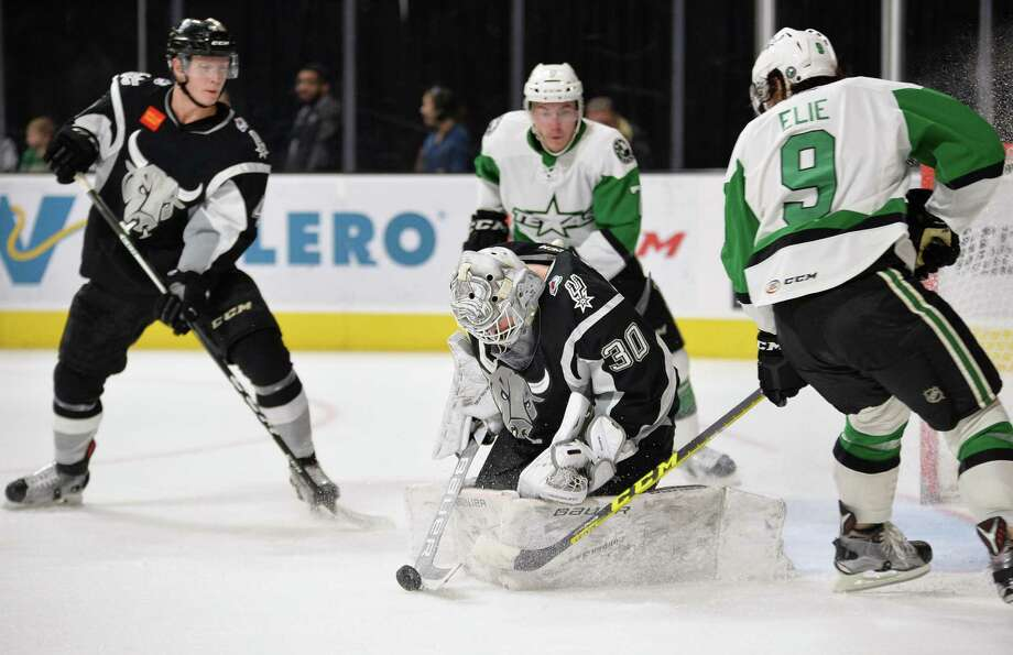 Rampage goaltender Spencer Martin stops a shot by Texas Stars left winger Remi Elie (9) during the first period of an AHL game on Dec. 27, 2016, in San Antonio. Photo: Darren Abate /AHL / Darren Abate Media, LLC