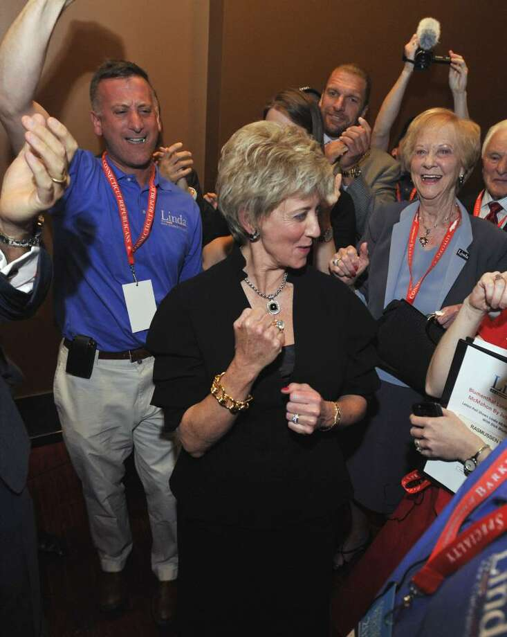Republican candidate for U.S. Senate Linda McMahon reacts after receiving the Republican nomination at the Connecticut Republican Convention in Hartford, Conn., Friday, May 21, 2010.  (AP Photo/Jessica Hill) Photo: Jessica Hill, AP / FR125654 AP