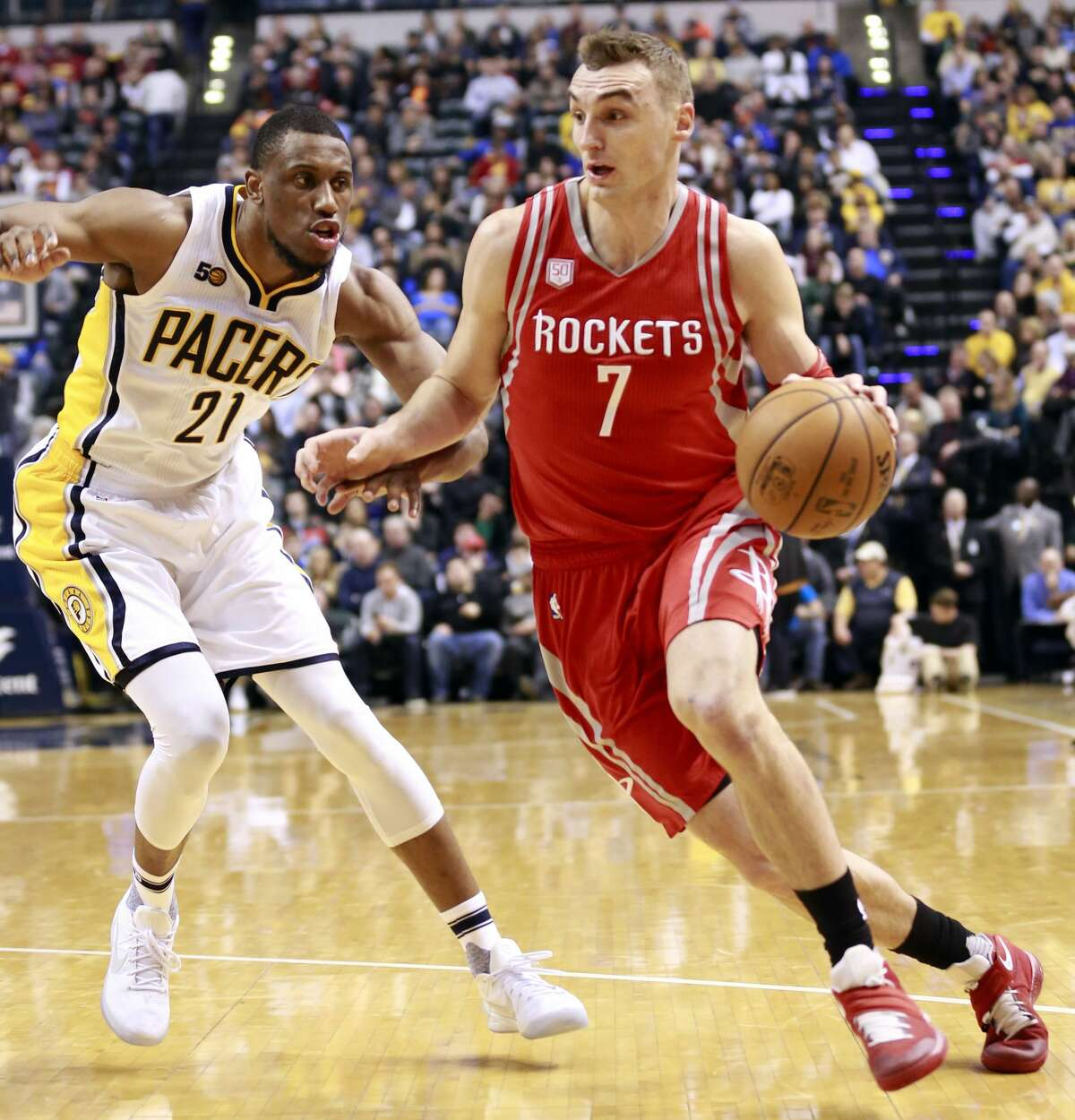 Houston Rockets forward Sam Dekker (7) dribbles around Indiana Pacers forward Thaddeus Young in the first half of an NBA basketball game, Sunday, Jan. 29, 2017, in Indianapolis. Indiana won 120-101. (AP Photo/R Brent Smith)