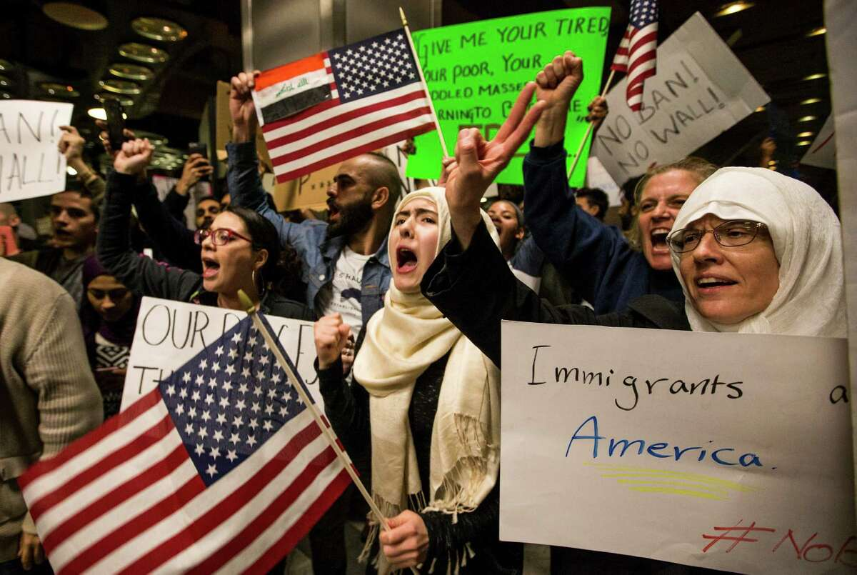 Demonstrators protest against President Donald Trump's executive orders on immigration at George Bush Intercontinental Airport on Sunday, Jan. 29, 2017, in Houston. Sunday's events continue a weekend of unrest in Houston and around the country as federal officials closed the border, blocking families from reuniting in the U.S. and refugees resettling around the country.