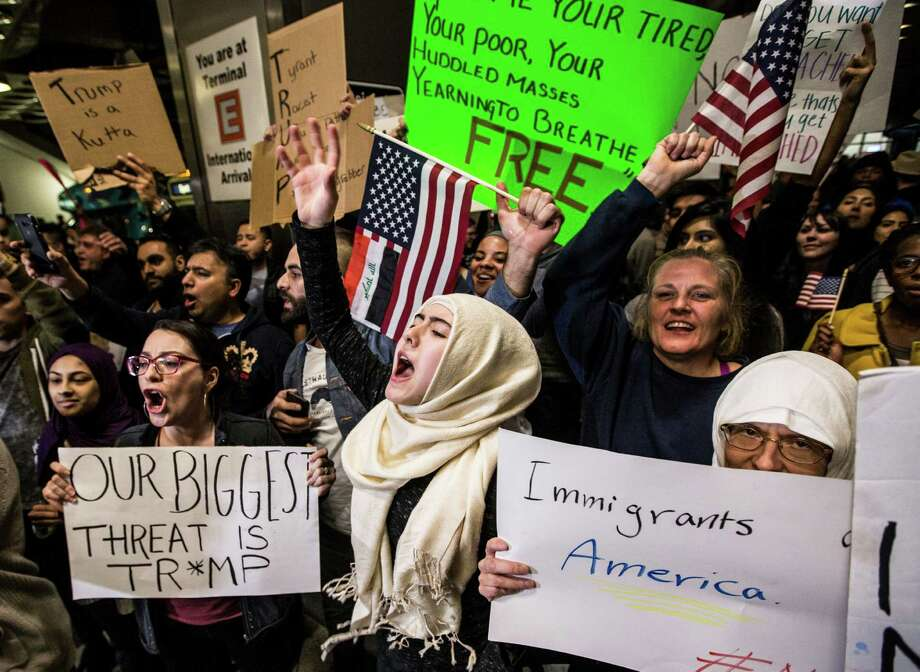Demonstrators protest against President Donald Trump's executive orders on immigration at George Bush Intercontinental Airport on Sunday, Jan. 29, 2017, in Houston. Sunday's events continue a weekend of unrest in Houston and around the country as federal officials closed the border, blocking families from reuniting in the U.S. and refugees resettling around the country. Photo: Brett Coomer, Houston Chronicle / © 2017 Houston Chronicle
