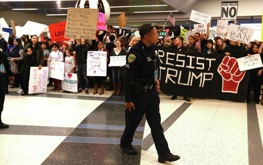 Demonstrators protest anti-immigrant policies and a Muslim travel ban instituted via executive order by the Trump administration as they fill the international arrivals area at George Bush Intercontinental Airport on Sunday. Photo: Brett Coomer, Houston Chronicle / Houston Chronicle 2017