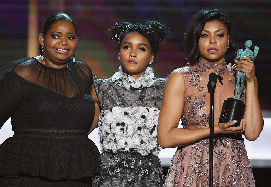 "Octavia Spencer (left), Janelle Monáe and Taraji P. Henson accept the award for outstanding performance by a movie cast for ""Hidden Figures"" at the 23rd annual Screen Actors Guild Awards in Los Angeles. Photo: Kevin Winter, Getty Images"