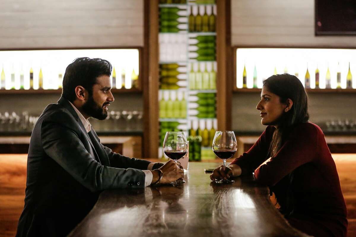 (l-r) Navreet Sharma and his fiancee Avneet Randhawa, who met on an Indian dating app Dil Mil have a drink at the Press Club in San Francisco, California on Thursday January 26, 2017.